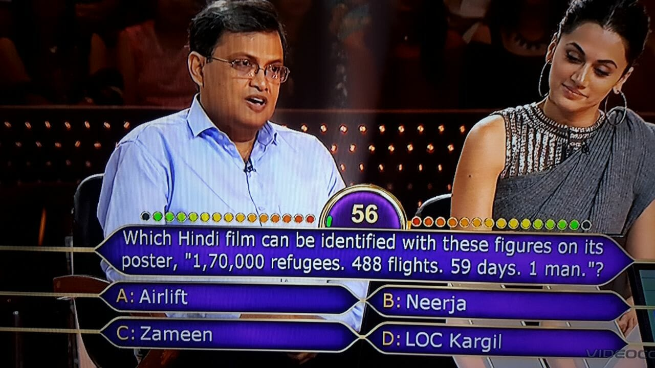 "Ques : Which Hindi film can be identified with these figures on its posters, ""1,70,000 refugees, 488 flights, 59 days, 1 man.""?"