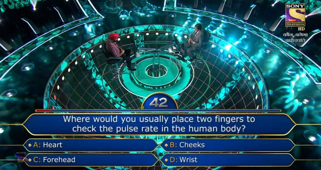 Ques : Where would you usually place two fingers to check the pulse rate in the human body?
